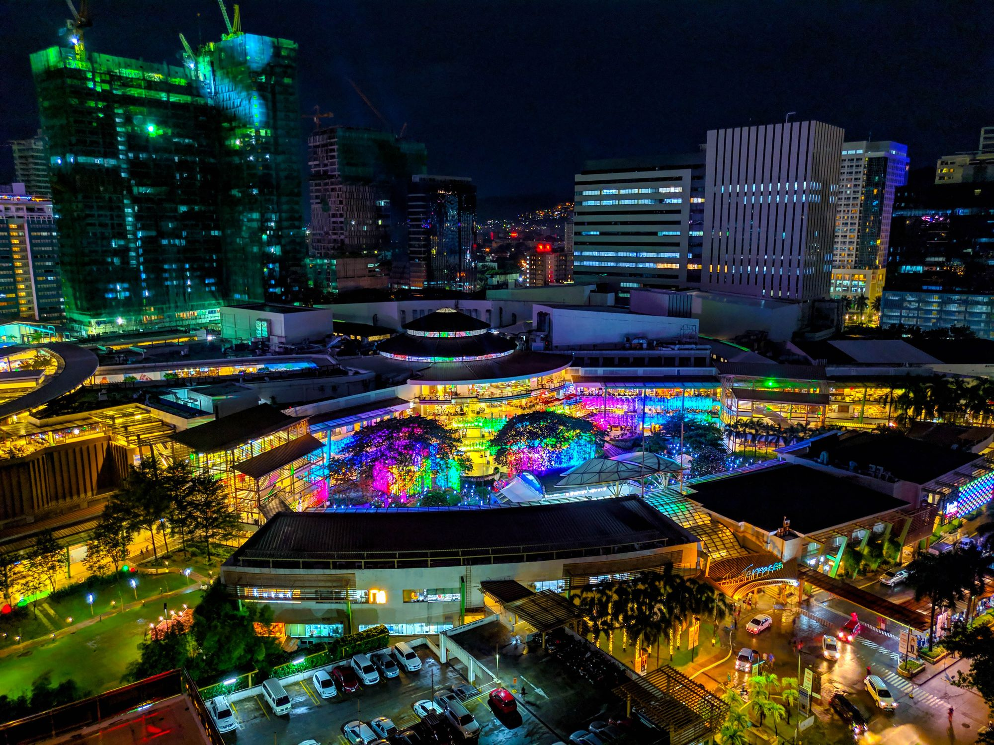 Buildings lit up with colorful lights at night in Cebu City, Philippines