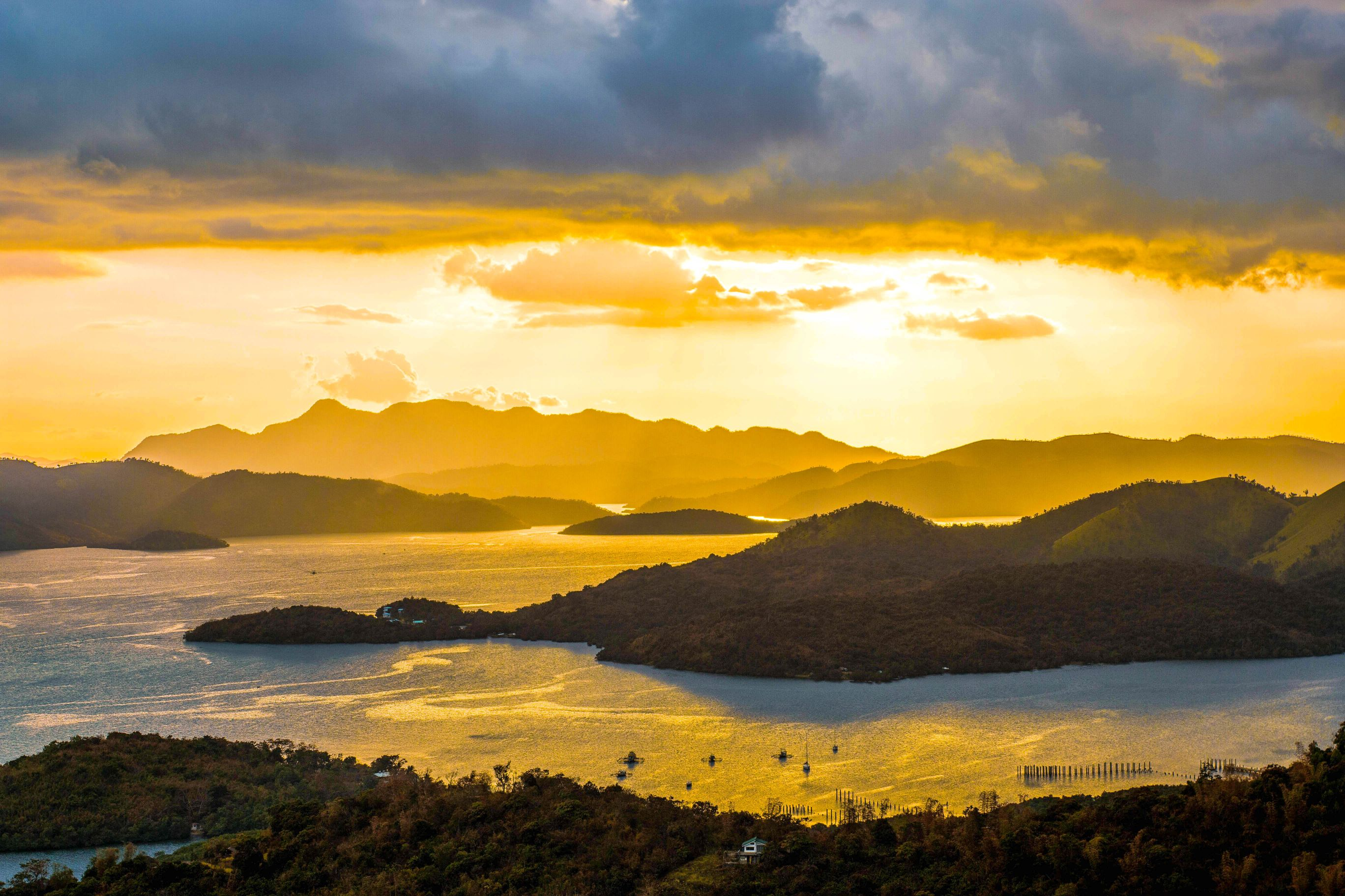 Sun setting over bays, inlets, and islands in Coron, Philippines
