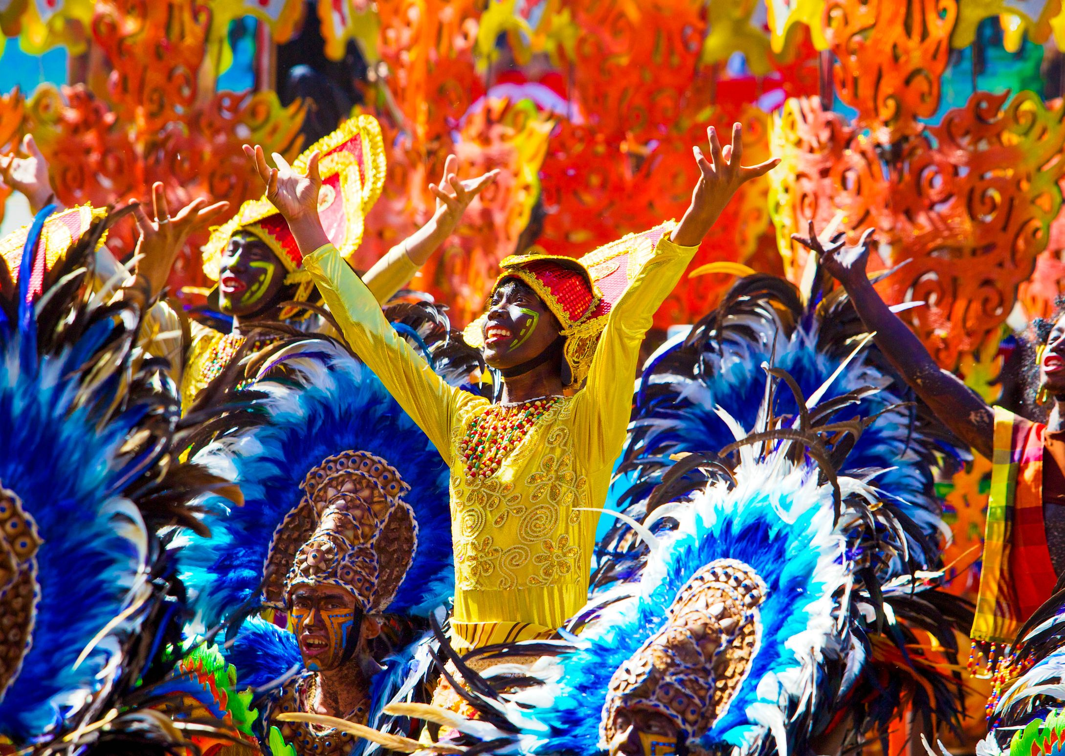 People in colorful costumes participating in a festival street parade