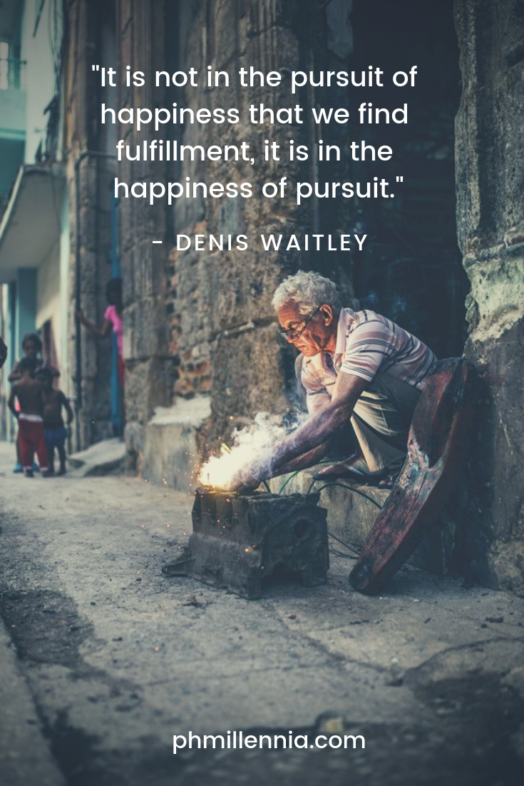 A quote on happiness by Denis Waitley on a background of an old man laboring passionately in his craft.