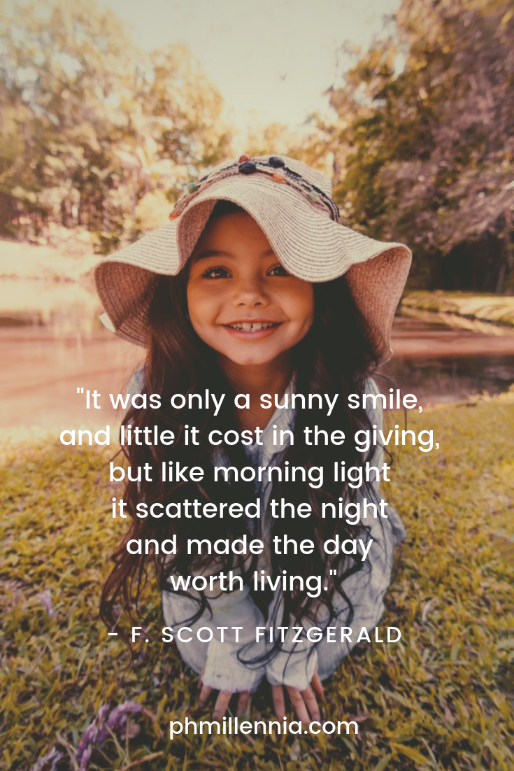 An adorable little girl smiles in happiness for the camera.