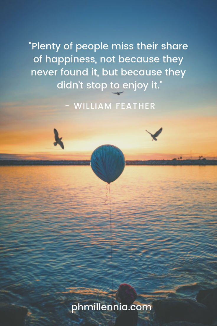 A quote on happiness by William Feather on a background of a balloon held aloft by a child before a lake aglow with the setting sun.