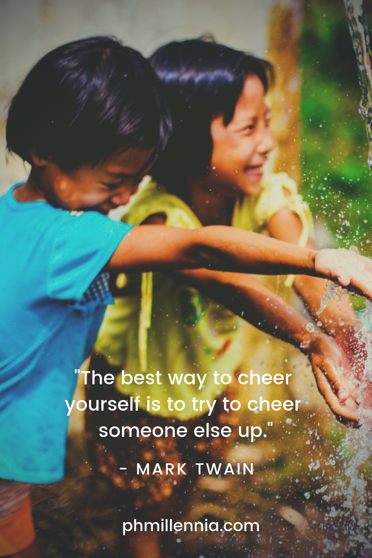 Two Southeast Asian kids delight in happiness as they play with water.