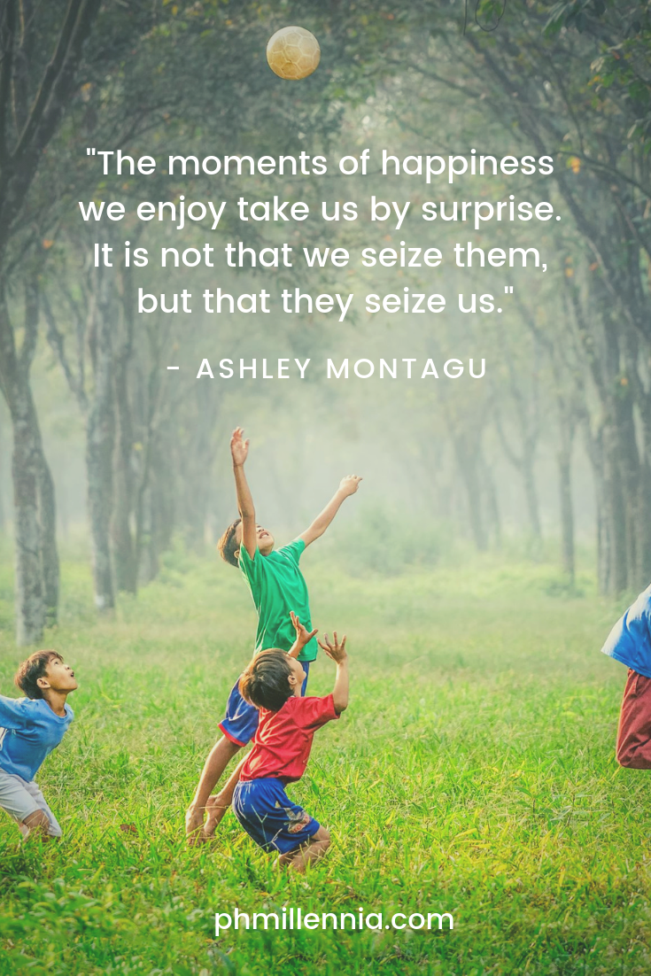 A quote on happiness by Ashley Montagu on a background of kids gamboling on a field.
