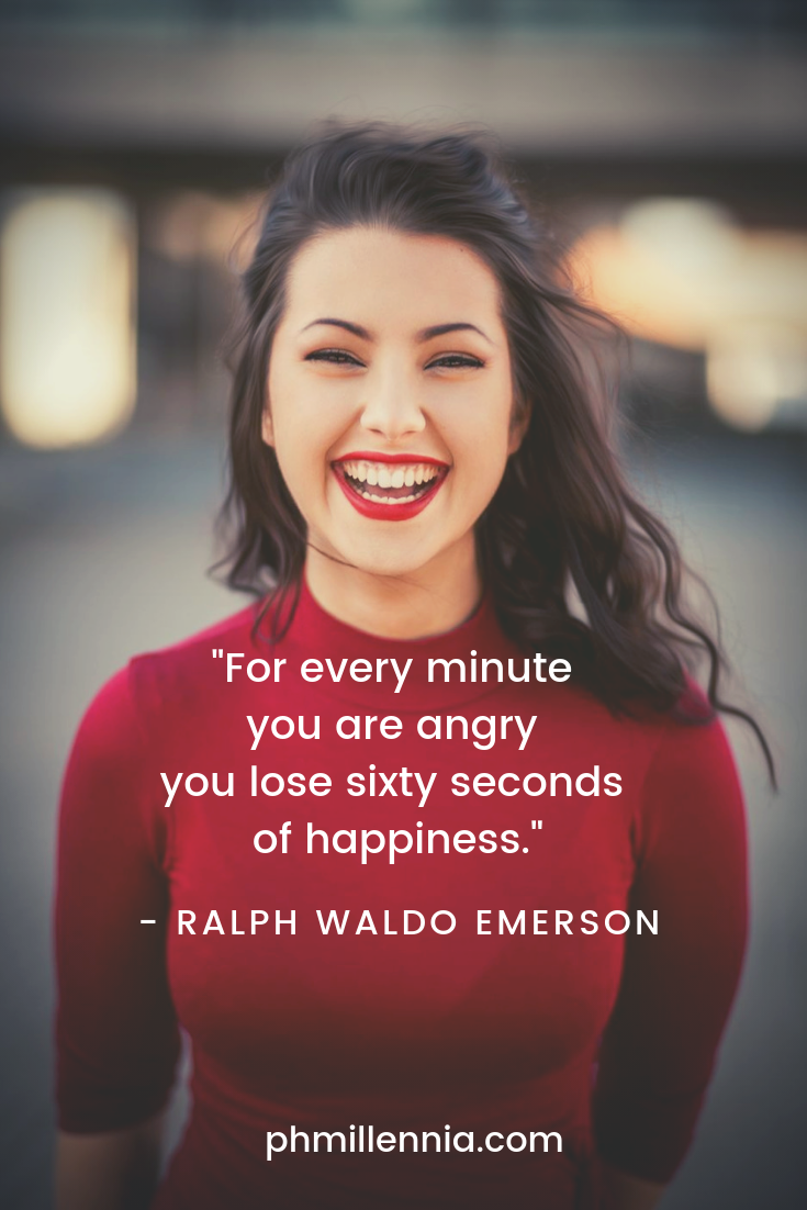 A beautiful woman in a red sweater radiates happiness as she smiles for the camera.