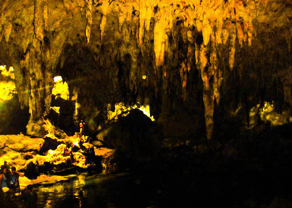 Darkened cave with bright stalactites and stalagmites in Panglao, Philippines