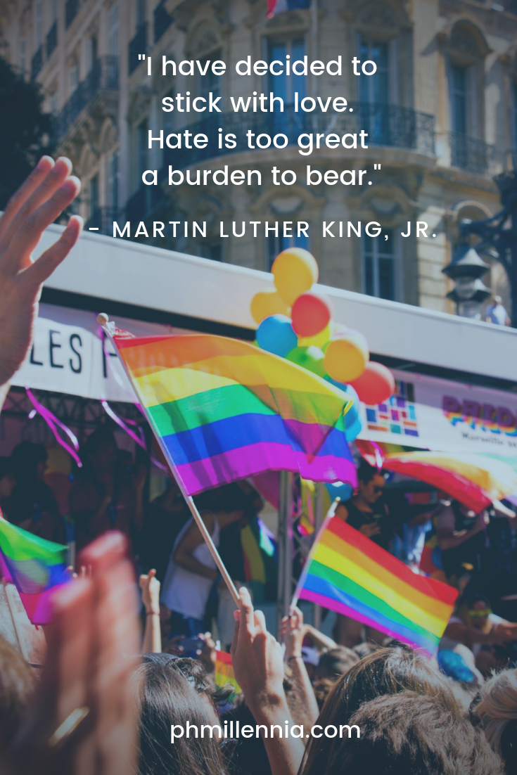 A quote on love by Martin Luther King on an image of a gay pride parade.