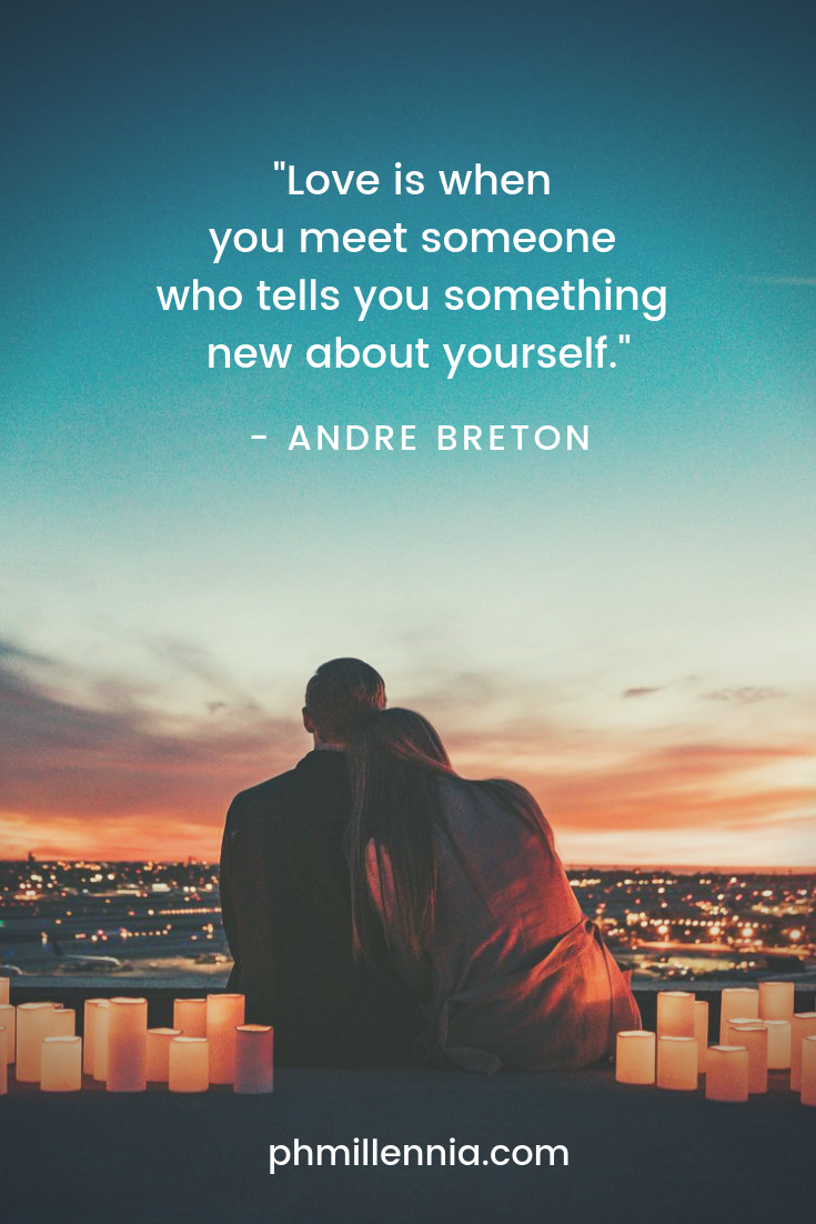 A quote on love by Andre Breton on an image of a couple embracing silhouetted against setting sun.