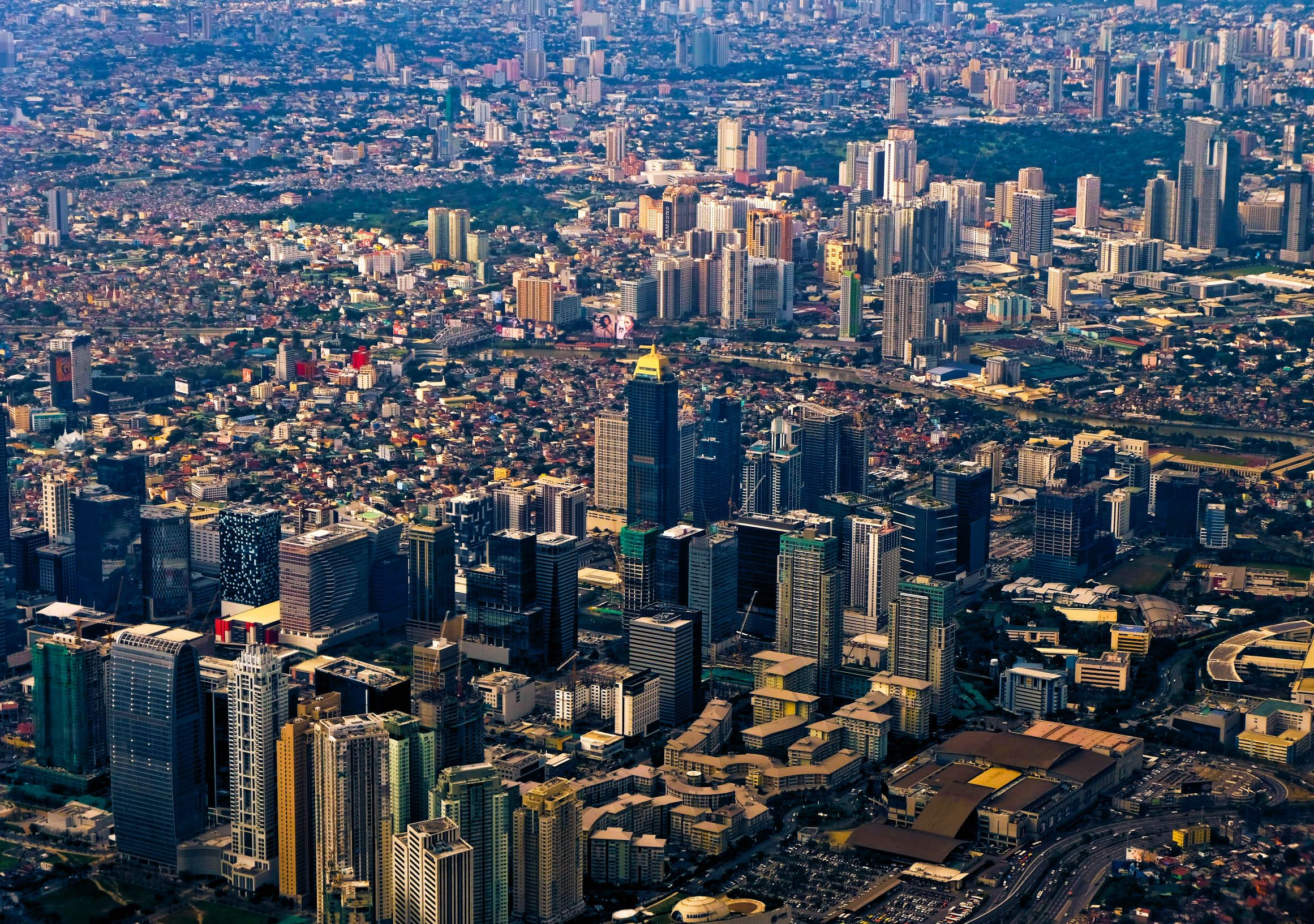 Aerial view of a large and sprawling city with numerous high rise buildings
