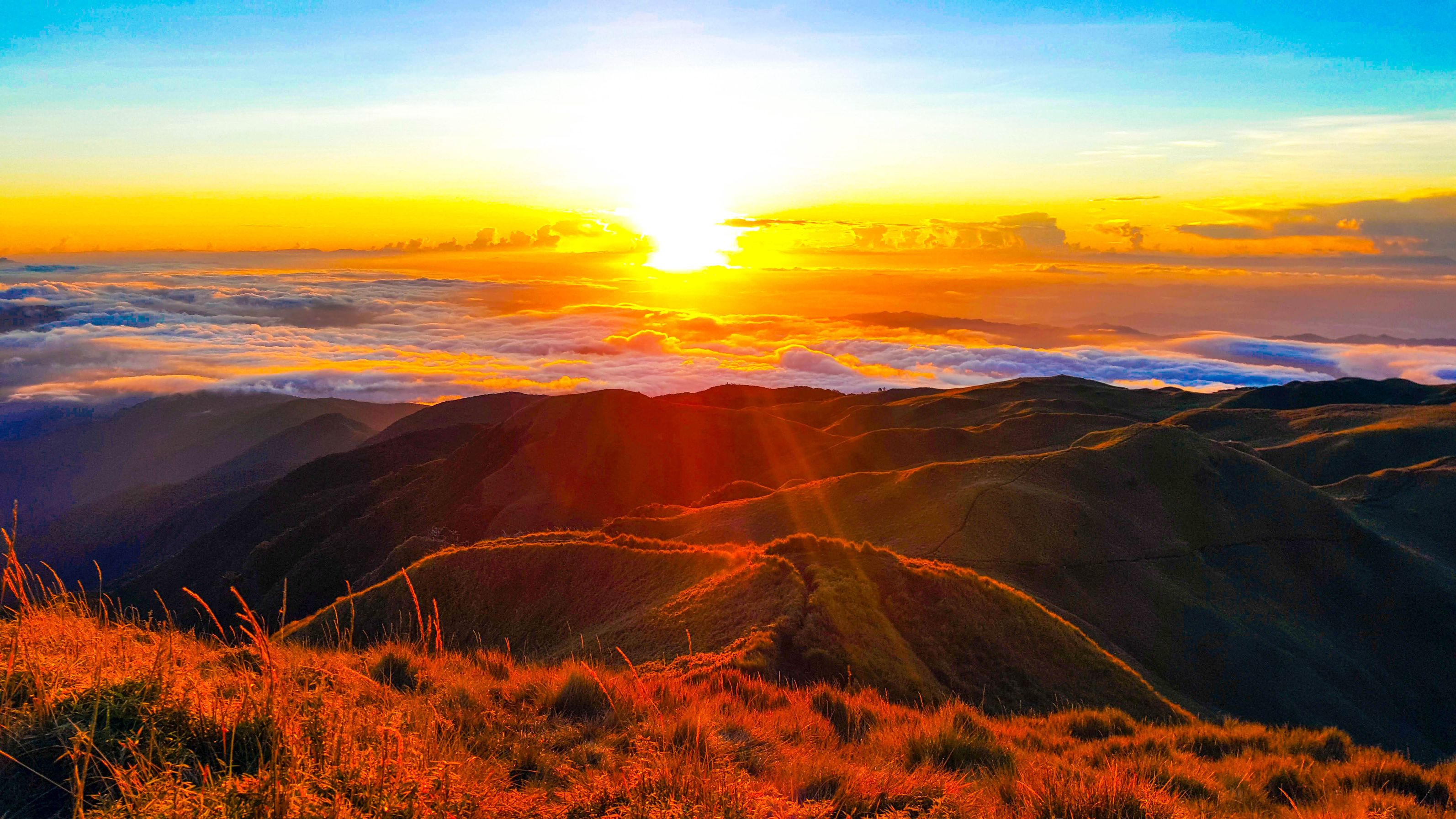 Sun rises above a sea of clouds on Mount Pulag, Philippines