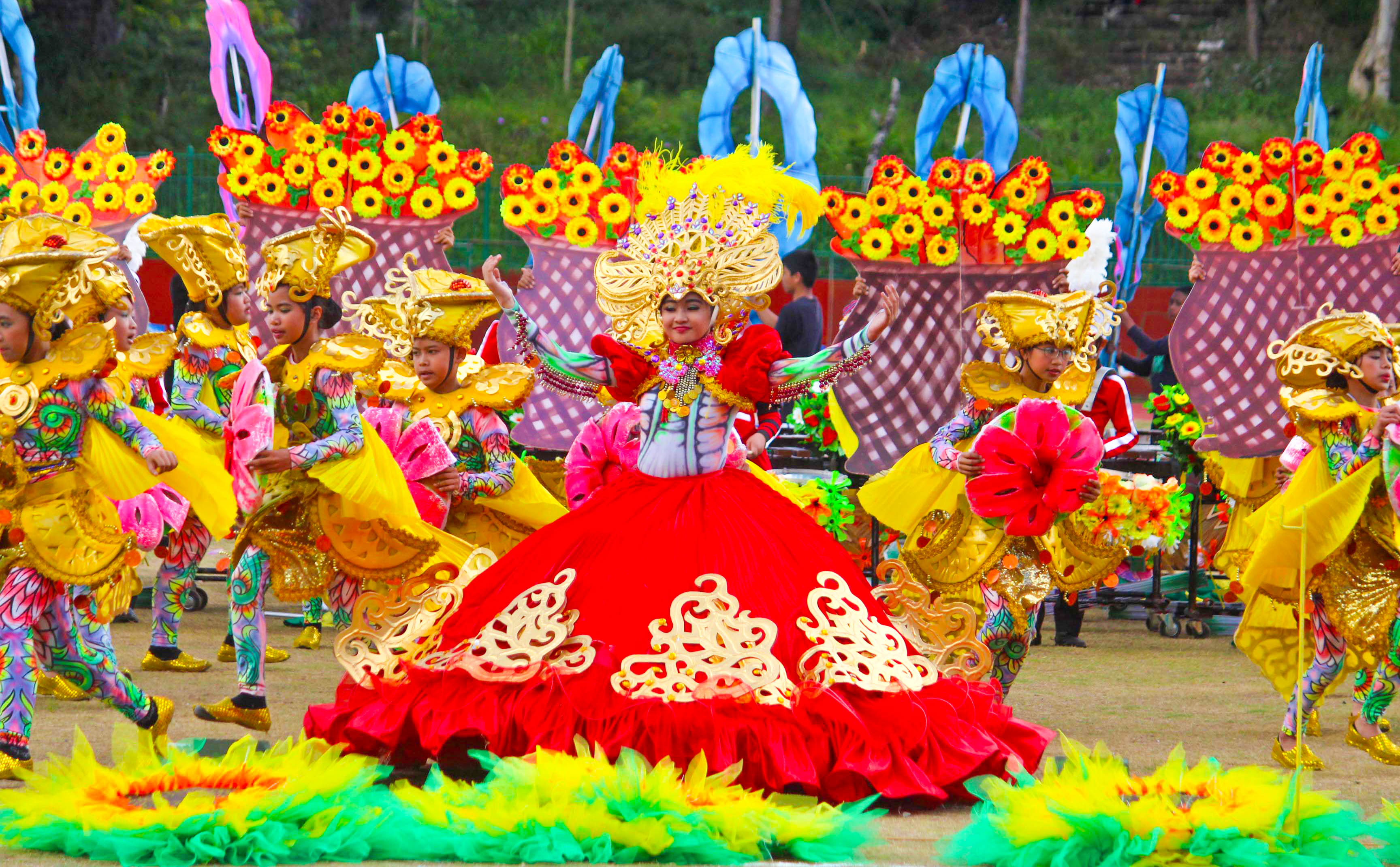Children dancing in colorful costumes during a festival parade