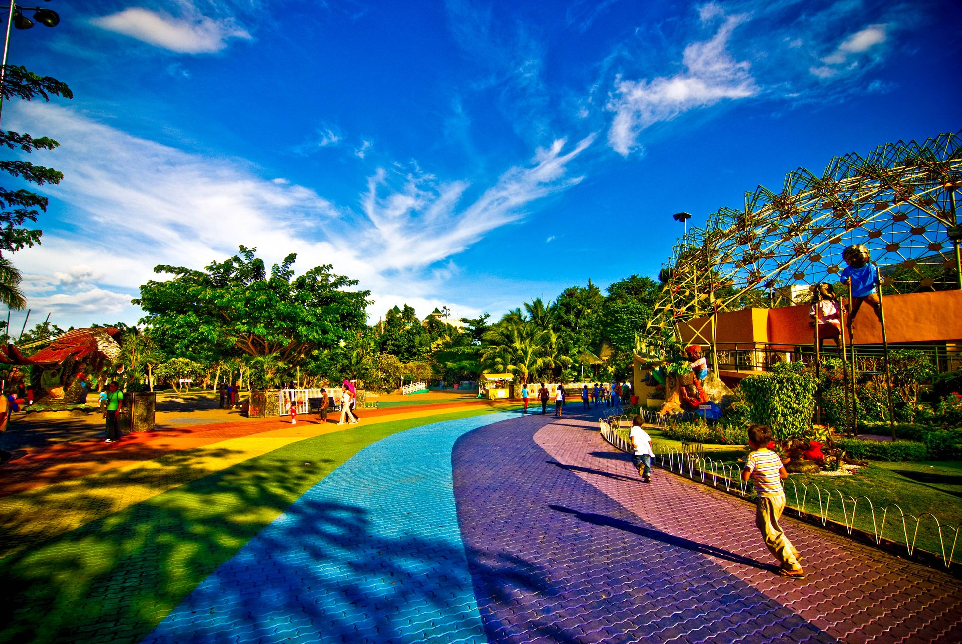 People in a park with a rainbow track in Davao City