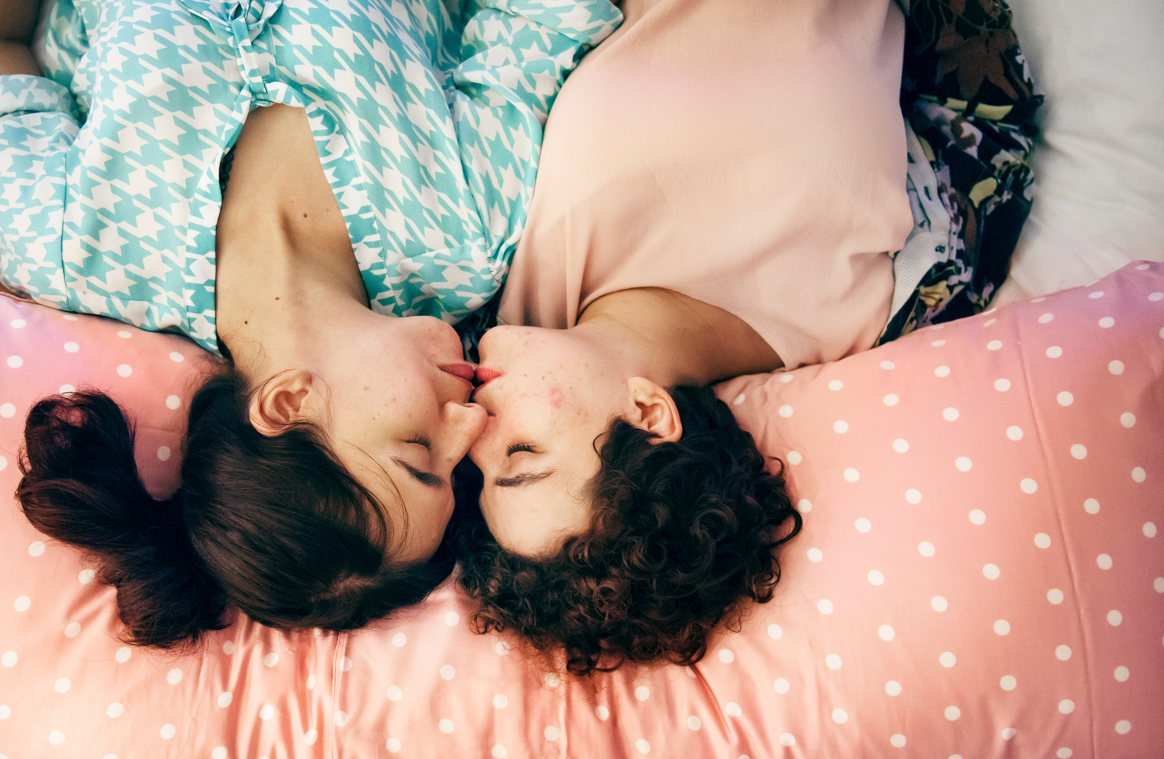Two girls in love kissing.