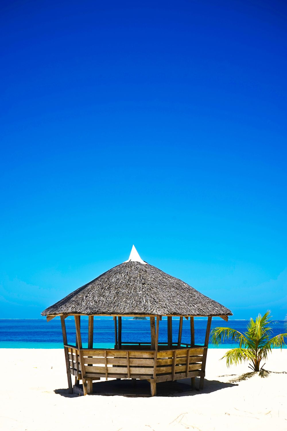 Thatched hut on a white sand beach in Siargao, Philippines