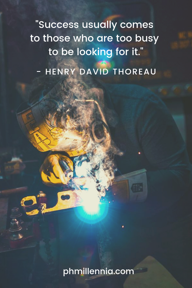 A quote by Henry David Thoreau on success on a background of a man welding.