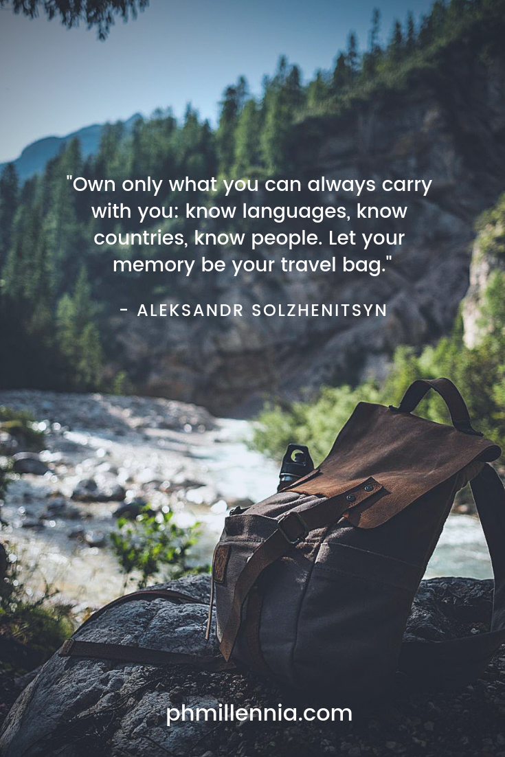 A quote on travel on an image of a backpack