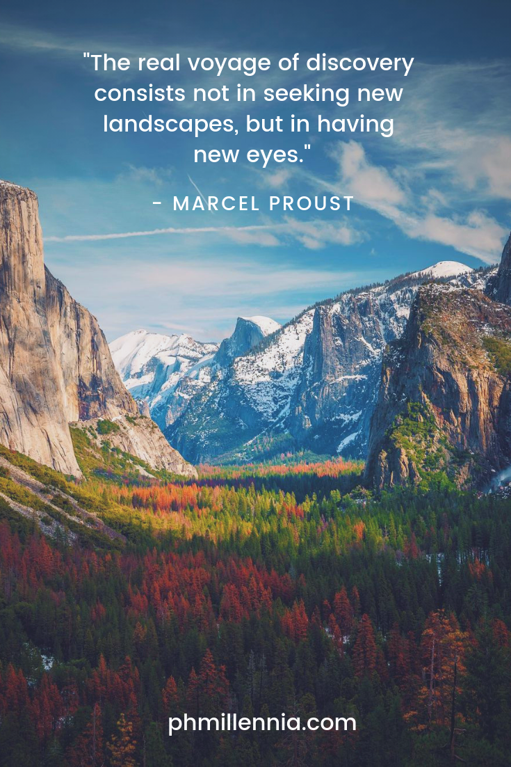 A quote on travel by Marcel Proust on an image of a majestic landscape in full bloom.