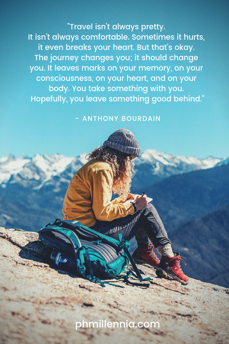 A quote on travel by Anthony Bourdain on an image of a traveler resting on the summit of a mountain