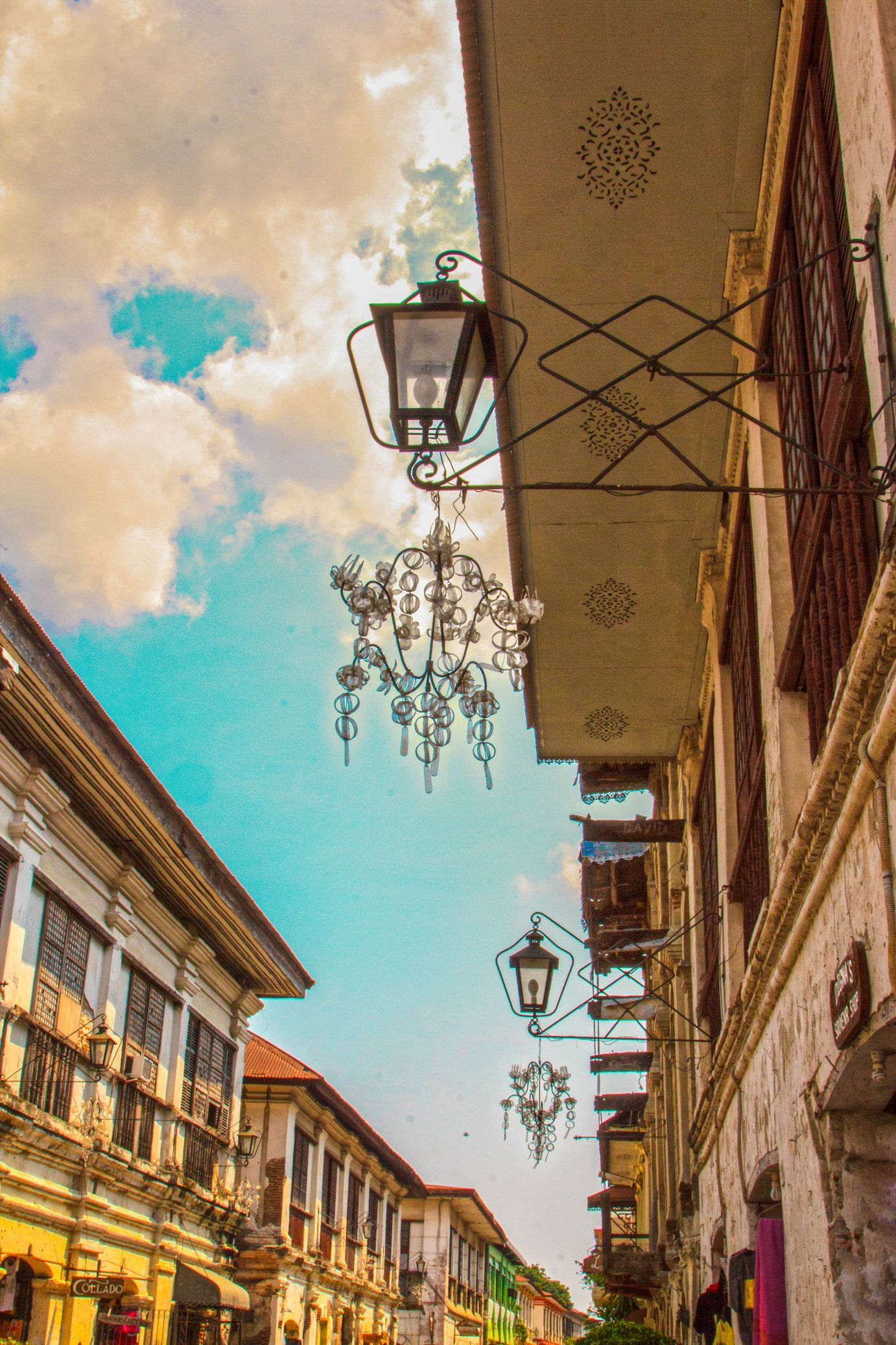Lamps hang on wrought-iron posts on Spanish colonial houses in Vigan City, one of the most amazing places to visit in the Philippines