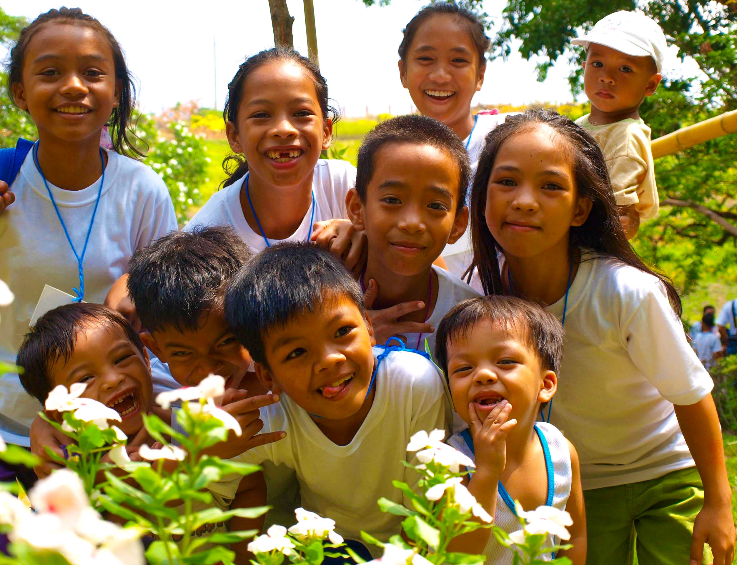 Filipino children smiling and laughing