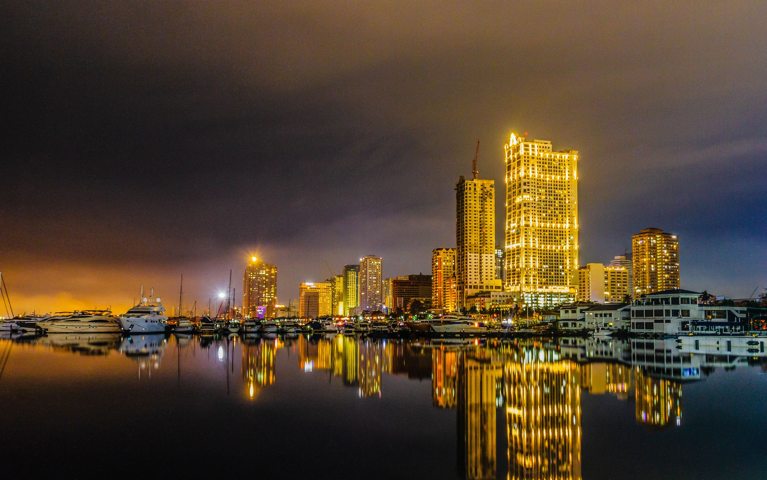 Skyline of Metro Manila at night reflected on water