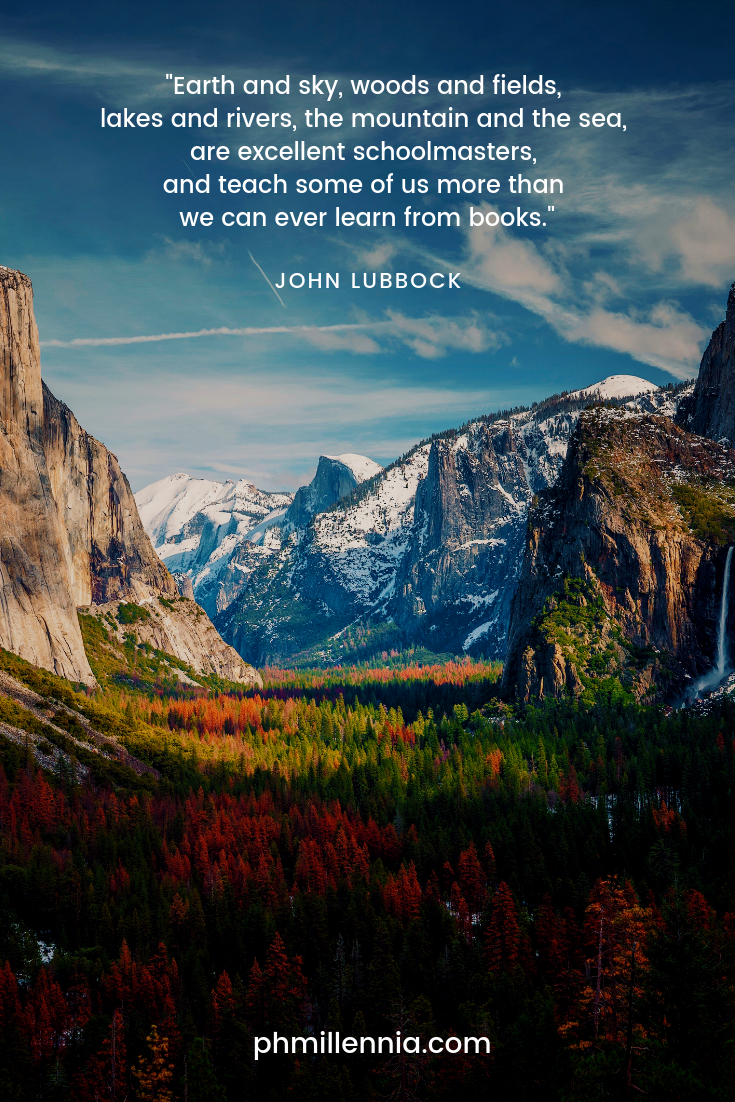 A quote on nature by John Lubbock on a background of a valley filled with trees in autumn