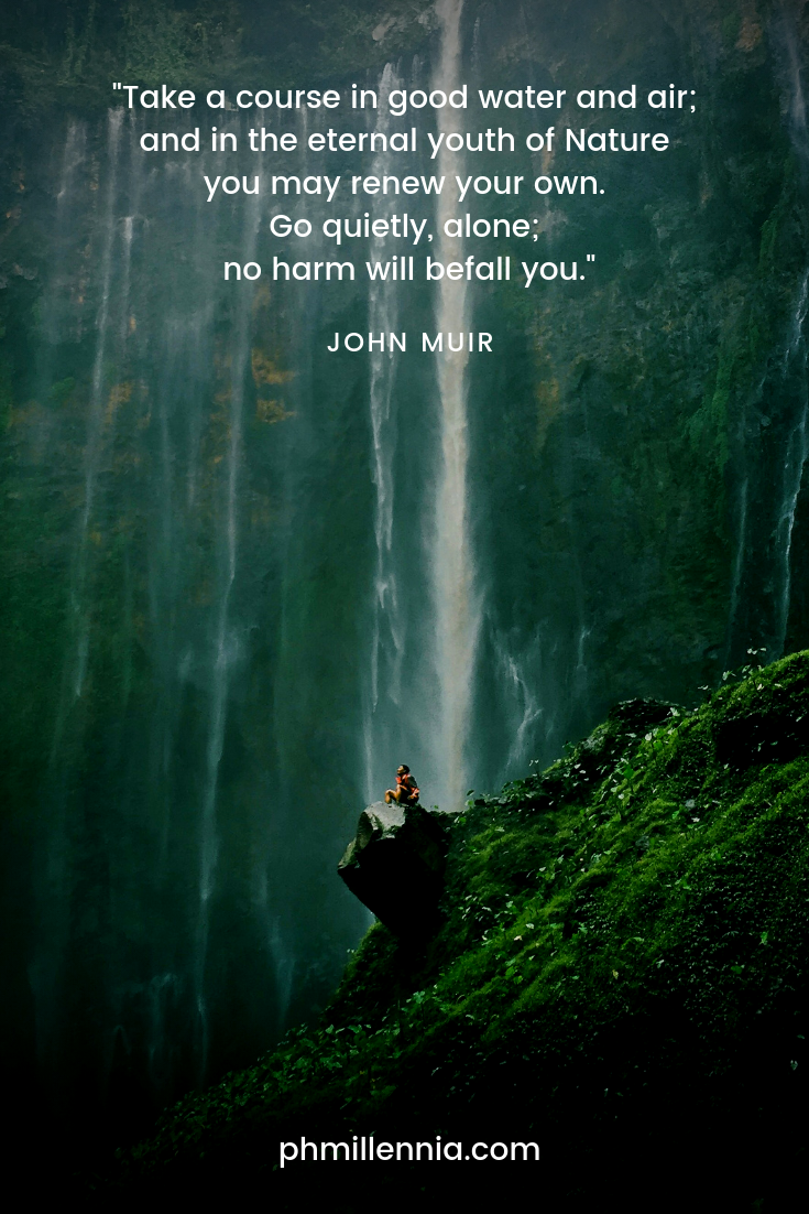 A quote on nature by John Muir on a background of a man sitting on a rock before a long and high waterfall