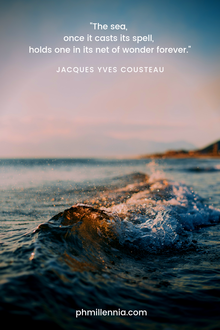 A quote on nature by Jacques Yves Cousteau on a background of a small wave in the sea