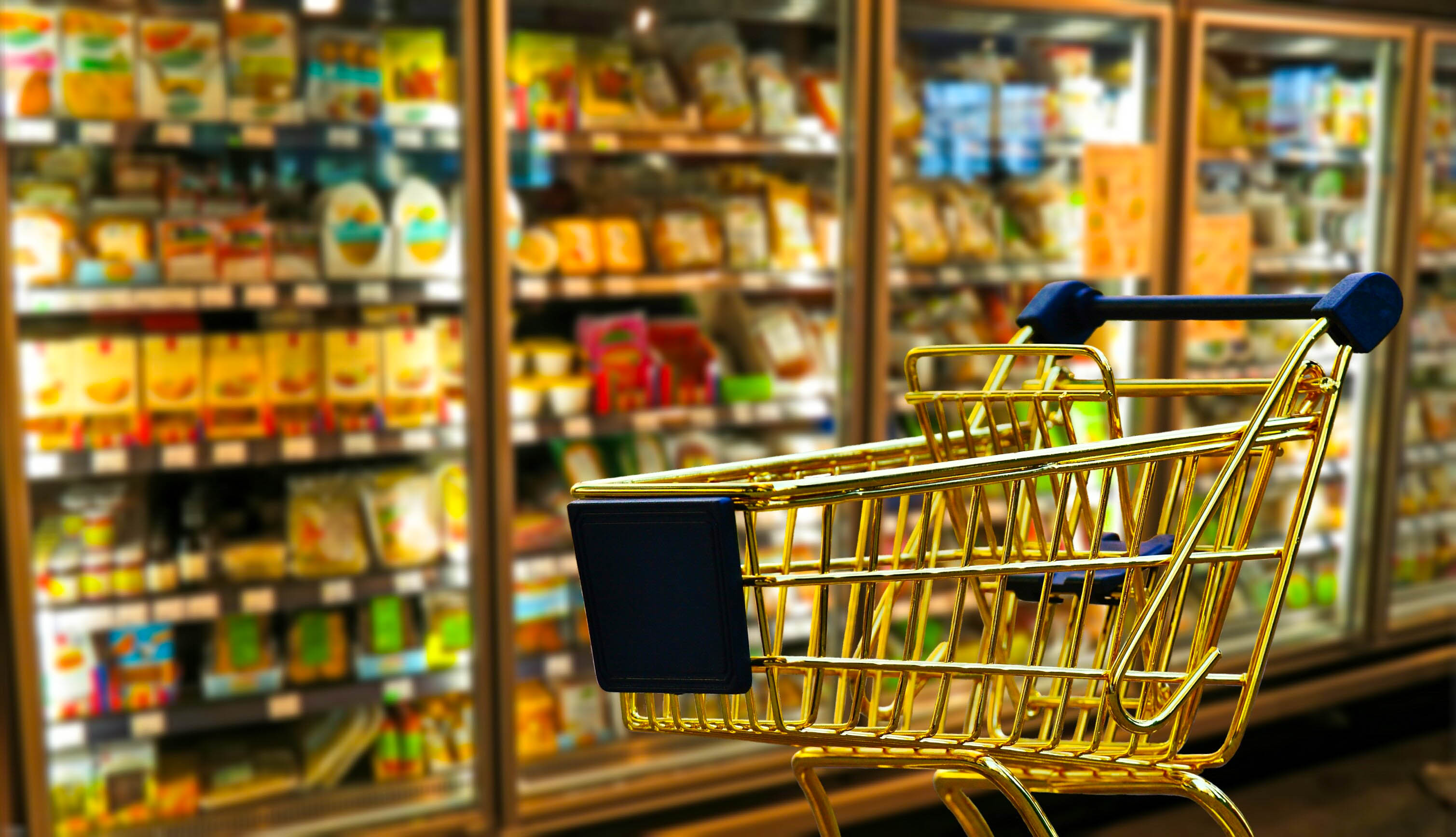 Grocery cart on a background of grocery items (in reference to planning your purchases as one way to save money)