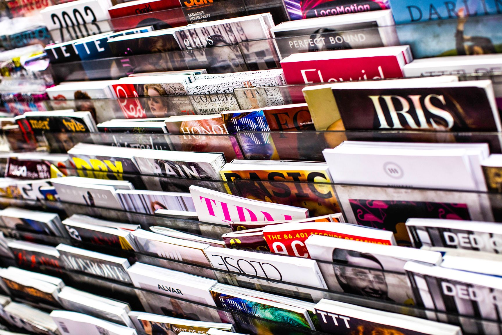 Numerous magazines on a magazine stand