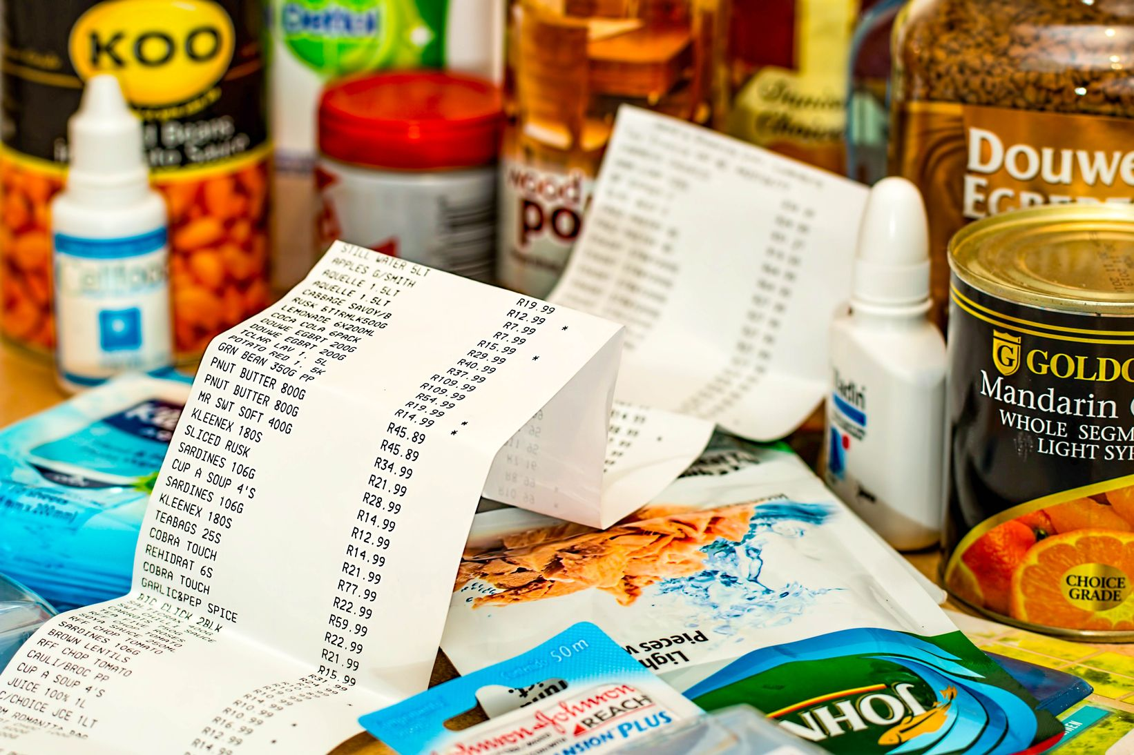 Receipt surrounded by grocery items