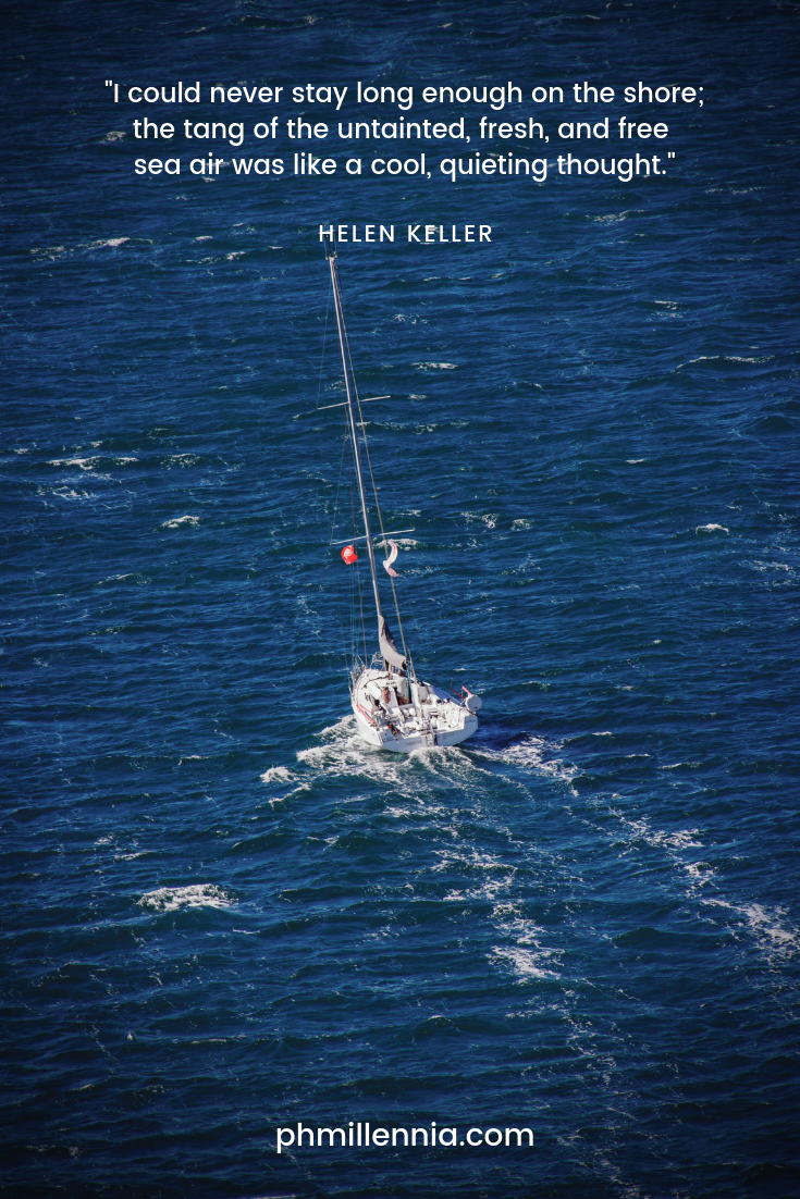 Quote about the sea by Helen Keller on a background of a sailboat on the blue sea