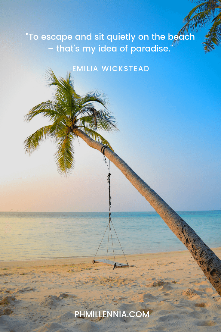 Swing hung on a coconut palm on a sandy beach