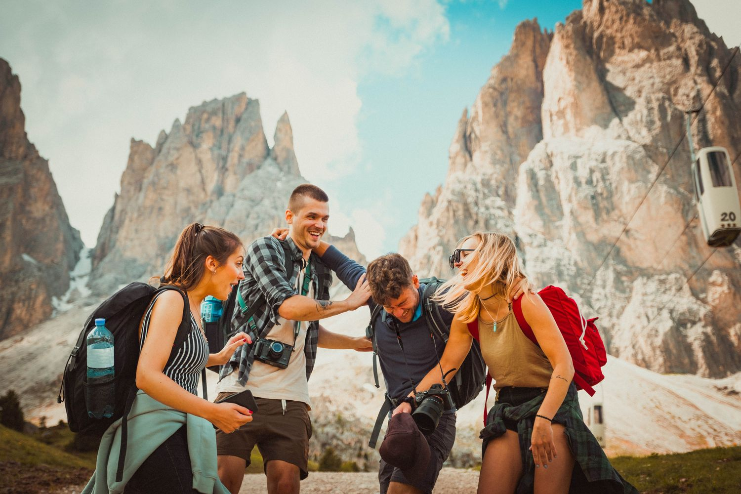 Group of backpacker friends on travel laughing