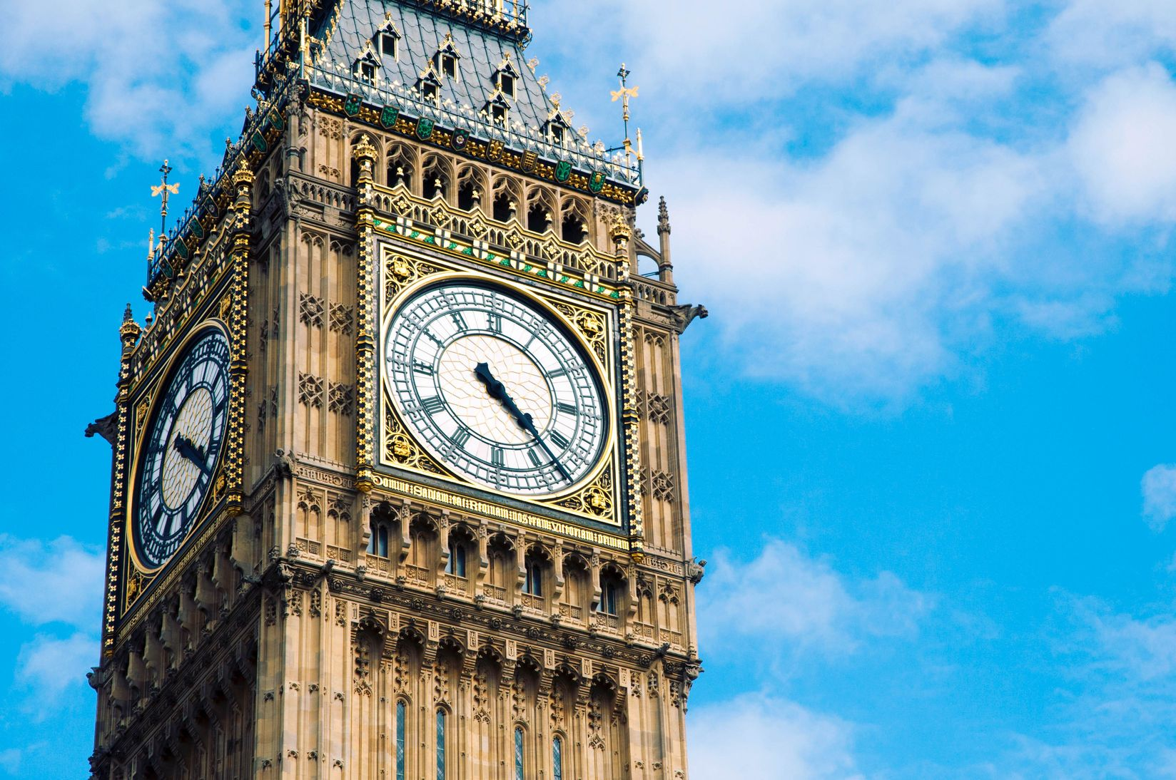 Photo of the Big Ben amidst a backdrop of a blue sky, indicating that time management is a career skills you learn from traveling