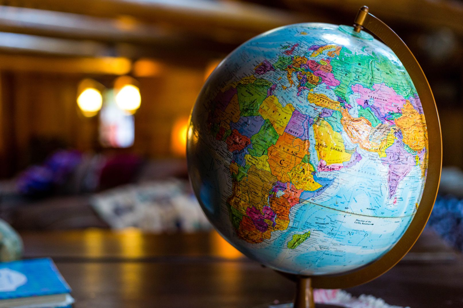 Photo of a globe standing on a wooden table