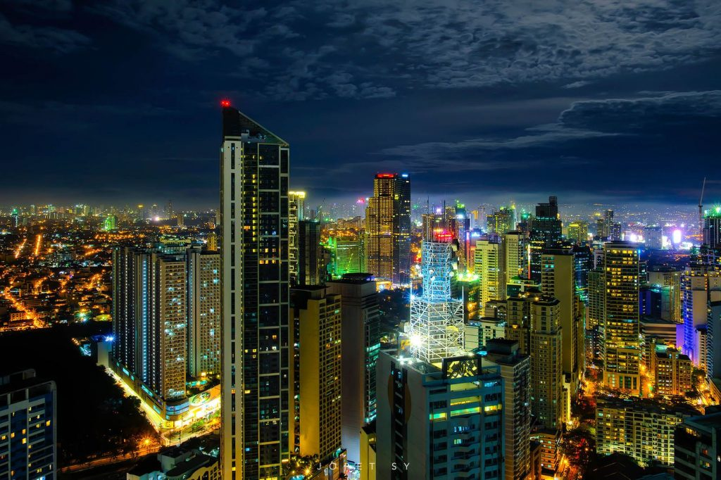 City skyscrapers at night in Metro Manila, one of the best places to visit in the Philippines