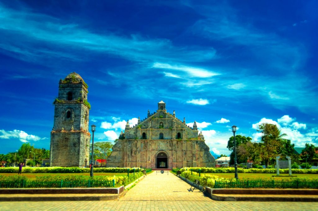 Stone church with a bell tower in Paoay, one of the best places to visit in the Philippines
