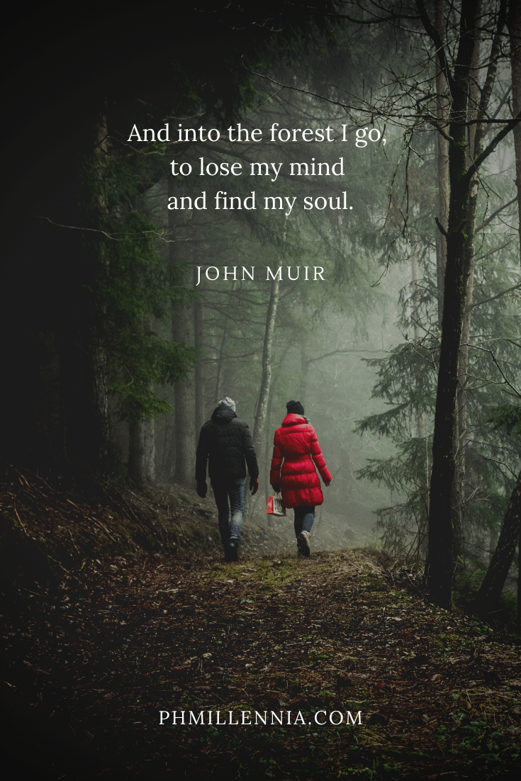 A quote by John Muir concerning woods on a background of a couple walking into a forest