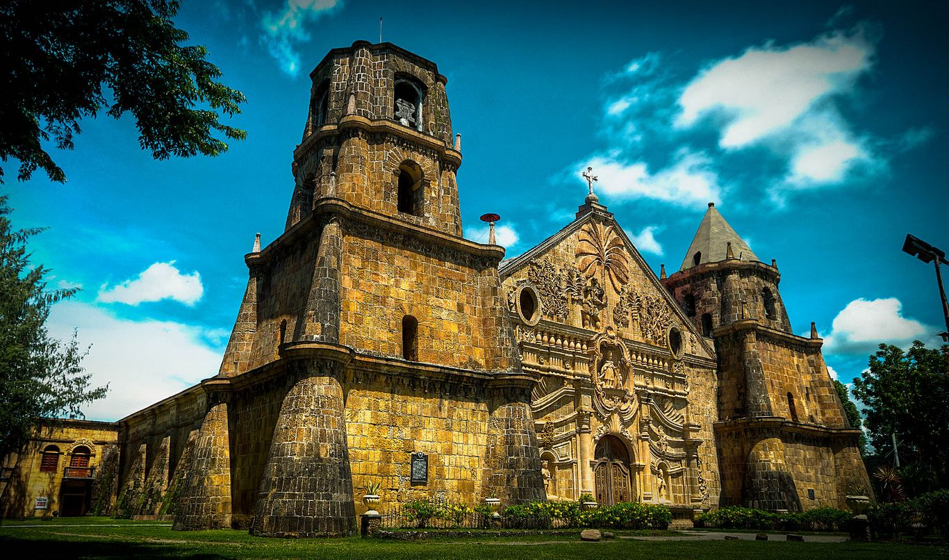 The two bell towers and facade of the old stone church of Miagao, one of the UNESCO World Heritage Sites in the Philippines