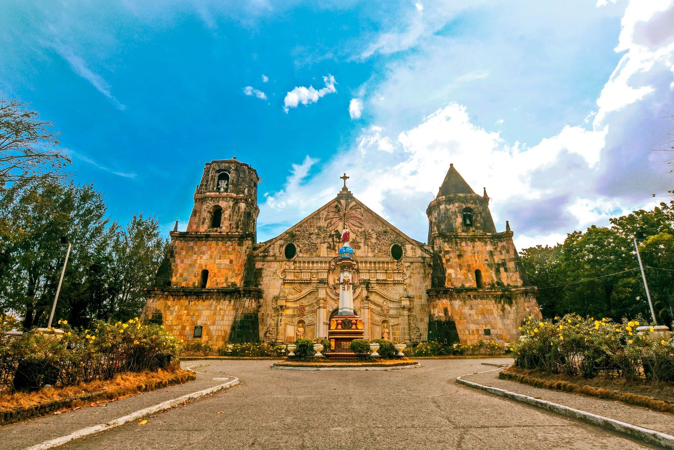 The facade and the two bell towers of the old stone church of Miagao, one of the UNESCO World Heritage Sites in the Philippines