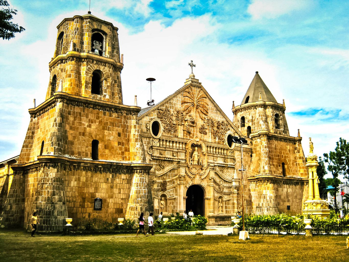 The wide facade and two thick bell towers of the old stone church of Miagao, one of the UNESCO World Heritage Sites in the Philippines