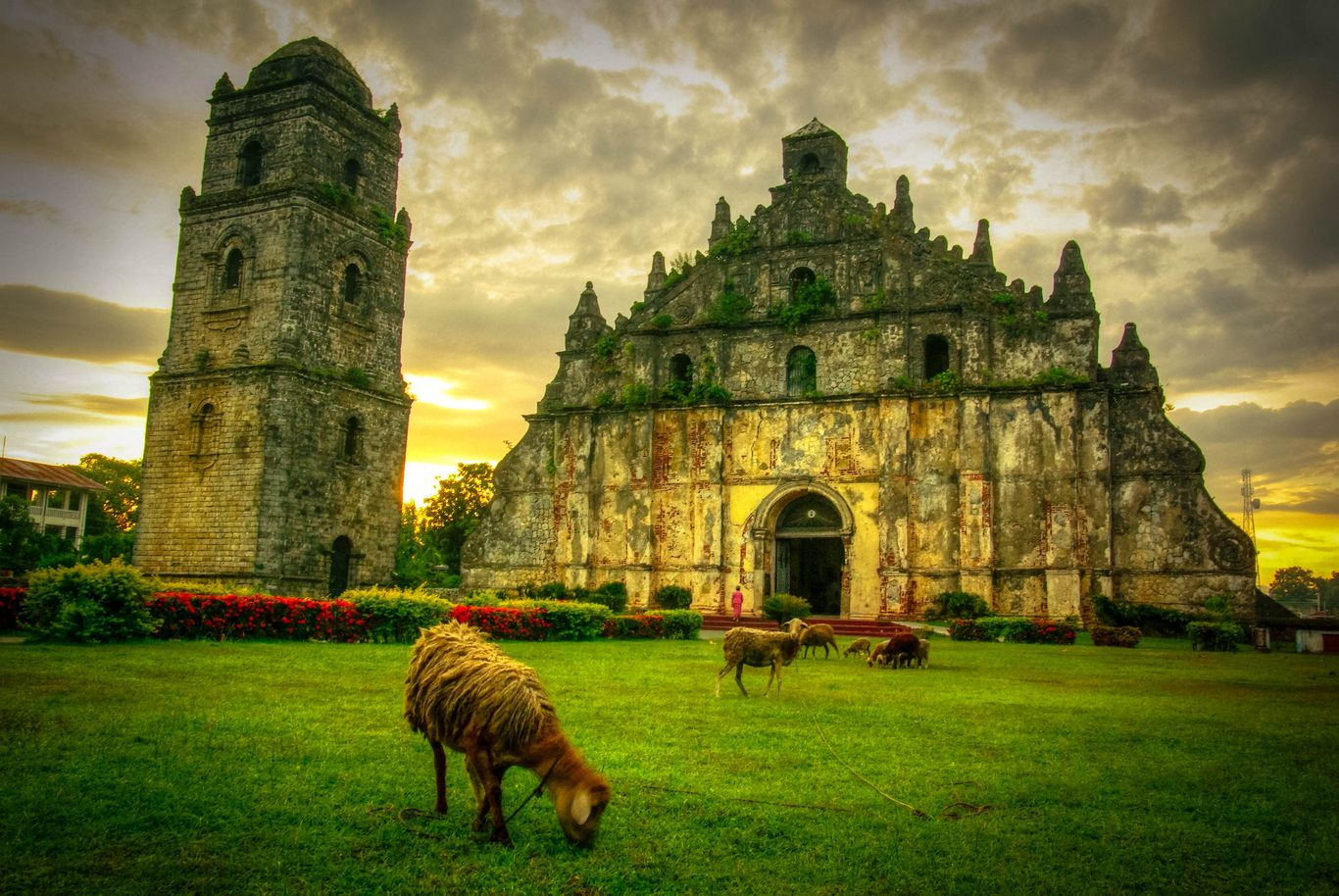 The stone bell tower and facade of the old Paoay Church, one of the UNESCO World Heritage Sites in the Philippines