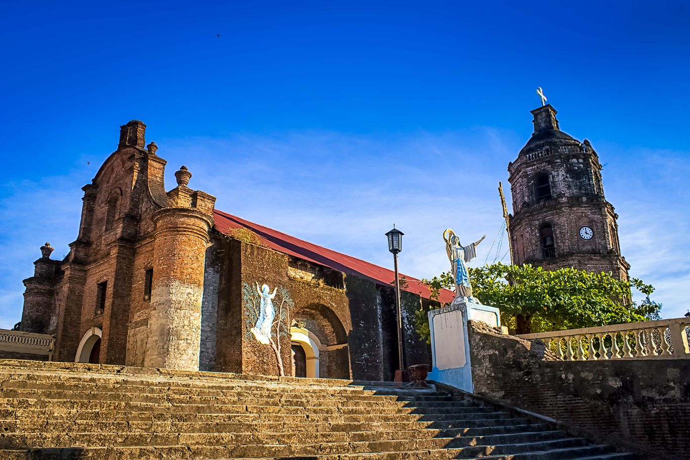 Stairs leading to the old brick church of Santa Maria, one of the UNESCO World Heritage Sites in the Philippines