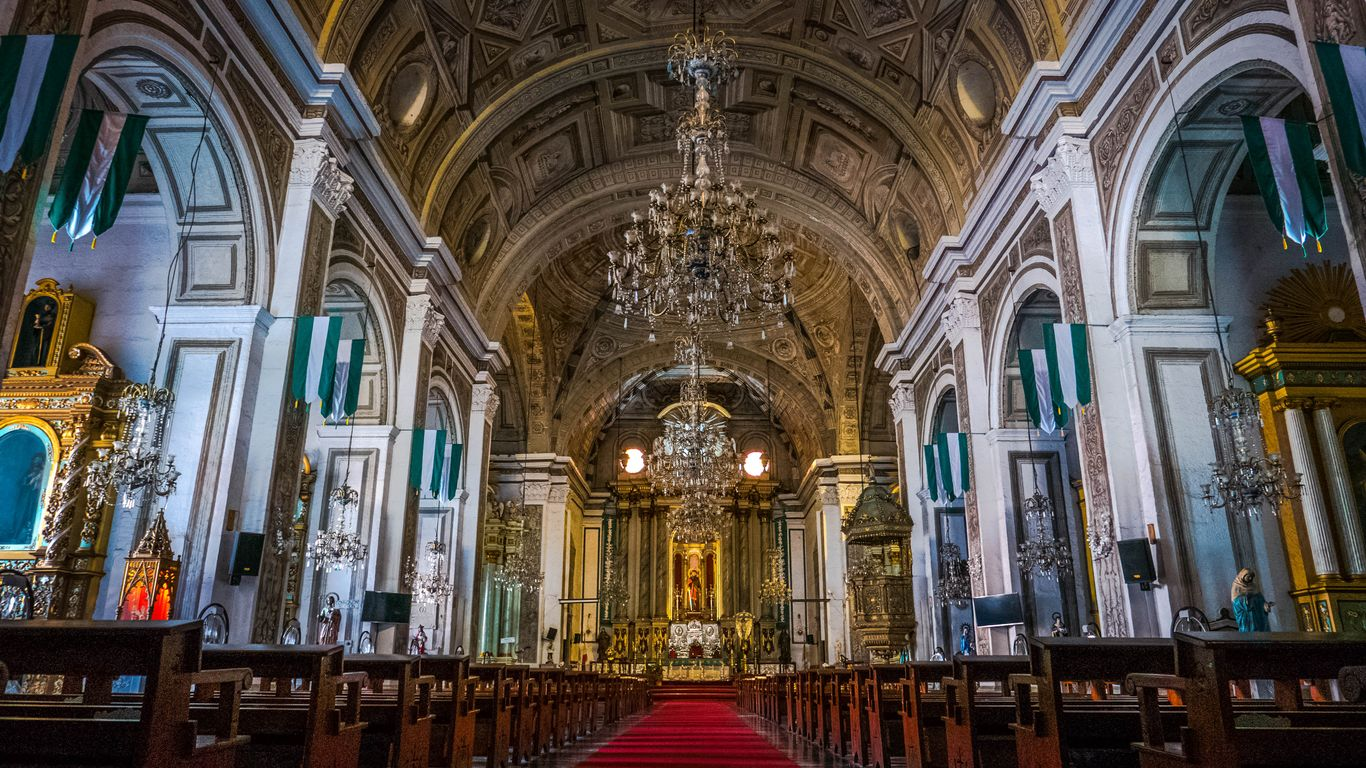 Richly painted, decorated, and furnished interior of the San Agustin Church in Intramuros, one of the UNESCO World Heritage Sites in the Philippines