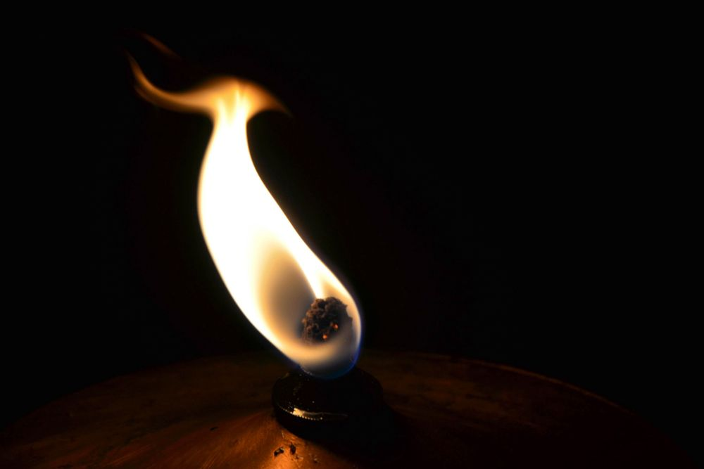 The flame of an oil lamp
