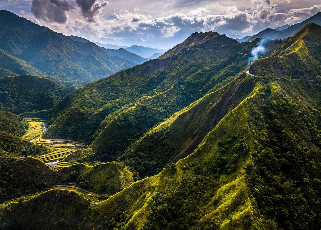Lofty mountains with steep, sharp, and vegetated slopes