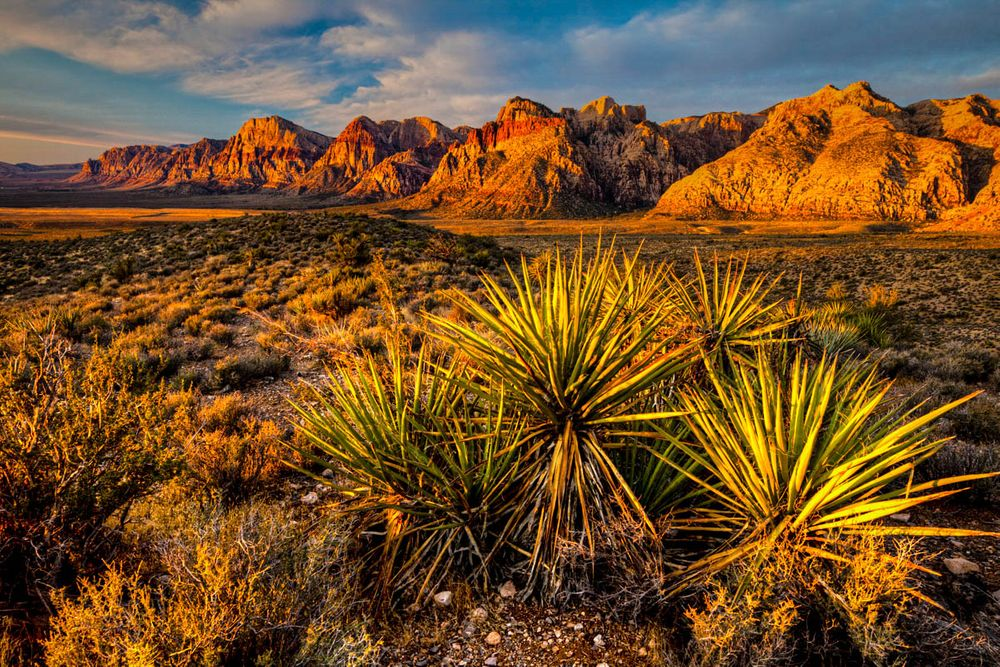 Red-brown rocky mountains rise over a desert landscape in Nevada, the chief setting of Mark Twain's novel 'Roughing It'
