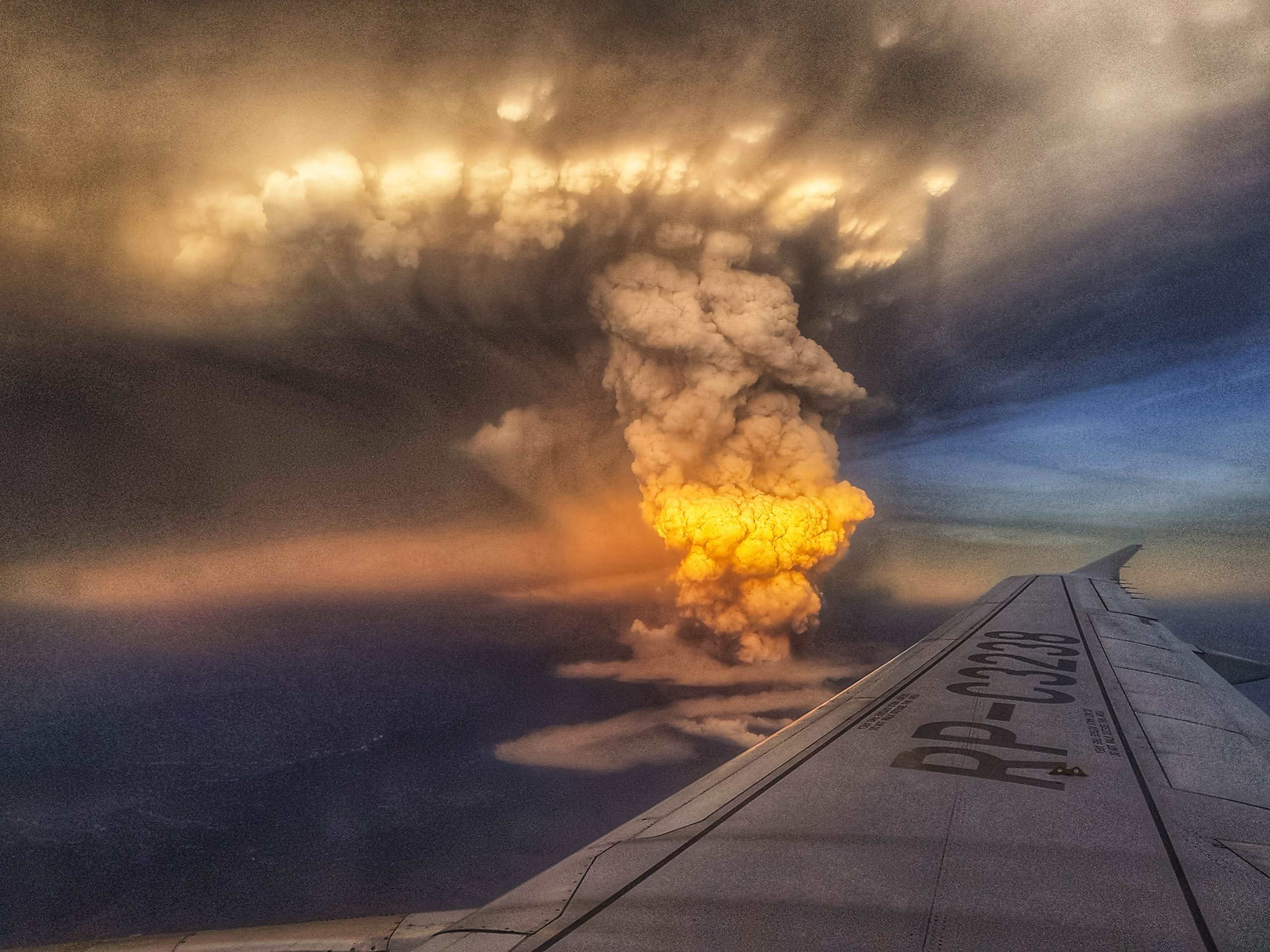An aerial view of a volcanic eruption
