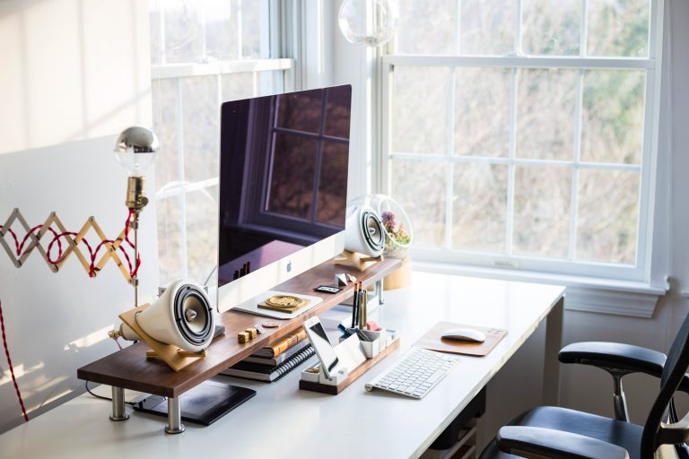 """A featured image for the article """"The Best Work from Home Essentials for Productivity and Comfort"""" on phmillennia.com"""
